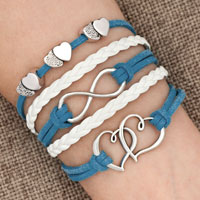 Bracelets - iced out sideways infinity open hearts in hearts ocean blue white braided leather rope bracelet Image.