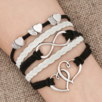 Bracelets - iced out sideways infinity open hearts in hearts black white braided leather rope bracelet Image.
