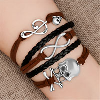 Bracelets - iced out sideways infinity skull music note brown black braided leather rope bracelet Image.