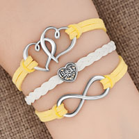 New Arrivals - iced out sideways infinity open heart in heart best mom heart charms yellow braided leather bracelet Image.