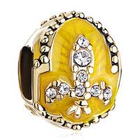 Charms Beads - 22k golden topaz yellow drip gum fleur de lis charm faberge egg Image.