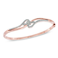 Bracelets - 1/4  ct.  t. w.  diamond cluster bangle in sterling silver and 14 k rose gold plate bracelet Image.