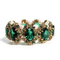 Bracelets - vintage green oval crystal golden tone vintage bangle charm bracelet Image.