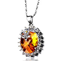 Necklace & Pendants - oval topaz crystal against flower pendant necklace Image.