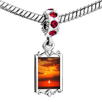 Charms Beads - red crystal dangle sunset over the ocean Image.