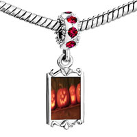 Charms Beads - red crystal dangle smiling jack o lanterns Image.