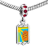 Charms Beads - red crystal dangle sunflower in sunlight Image.