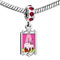 Charms Beads - red crystal dangle birthday cake in spotlight Image.