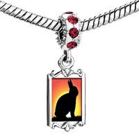 Charms Beads - red crystal dangle golden sunset burning across the rabbit Image.