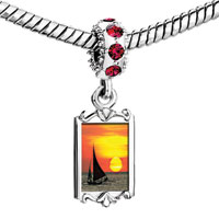 Charms Beads - red crystal dangle sailing boat on sea at sunset Image.