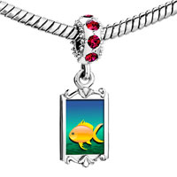 Charms Beads - red crystal dangle yellow fish in blue ocean Image.