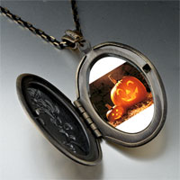 Necklace & Pendants - smiling jack o lantern halloween pumpkin face lanterns oval and flower yellow pendant Image.
