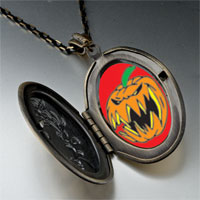 Necklace & Pendants - scary jack o lantern halloween pumpkin oval and flower yellow pendant Image.