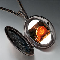 Necklace & Pendants - smiling jack o lantern halloween pumpkin face lanterns oval and flower pendant Image.