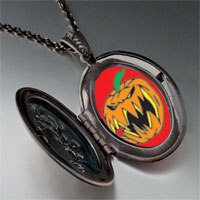 Necklace & Pendants - scary jack o lantern halloween pumpkin oval and flower pendant Image.
