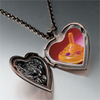 Items from KS - plastic orange dreidel heart locket pendant necklace Image.